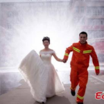 Hilarious: Fire-fighter poses for unconventional wedding photos with his partner