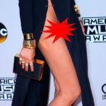 AMA's Red Carpet: Chrissy Teigen suffers x-rated wardrobe malfunction as shocking thigh-high splits