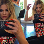 Khloe Kardashian shows off her EXTREME curves and slender figure as she snaps festive waist-training selfie