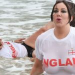 Big Brother's Lisa Appleton flashes her assets in England T-shirt as she rolls around in Spanish sea