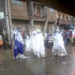 Eyo masquerades defy rainfall, move around in their attire – SEE PHOTOS
