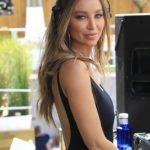 Lauren Pope showcases her enviable abs and sizzling curves in a cobalt blue bikini as she parties in Marbella