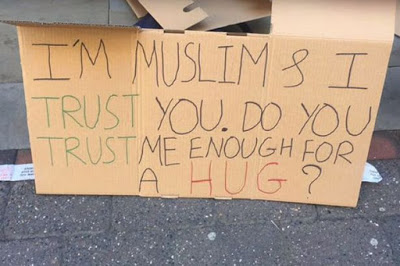 Stunning Blindfolded Muslim Man Offers Free Hugs In Manchester City Days After Attack