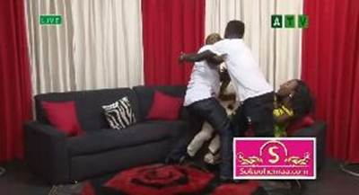 boxer, Aww! Ghanaian boxer, Ayittey Powers beats up comedian on Live TV – Watch Video