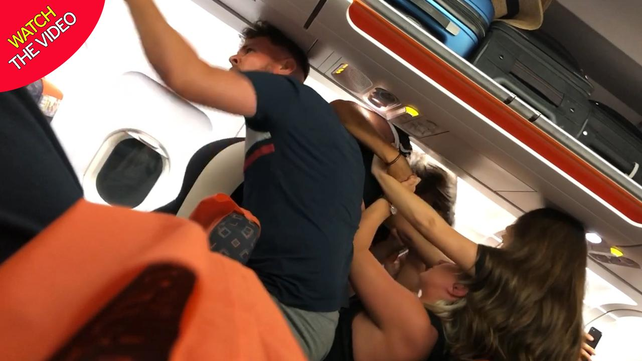 passengers, Easyjet passengers in extraordinary mass brawl 'after woman gets breasts out' and starts 'giving lapdances'