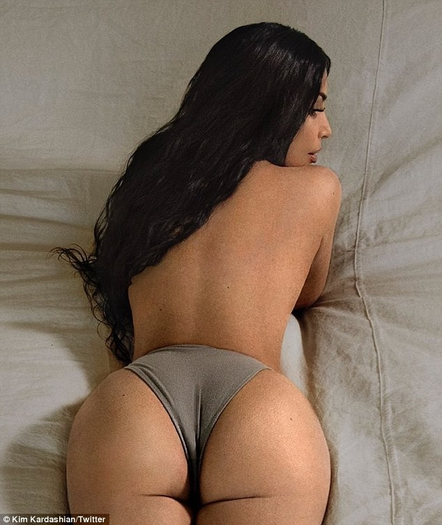Kim Kardashian flaunts goes topless on perky derriere in tiny underwear (Photos)