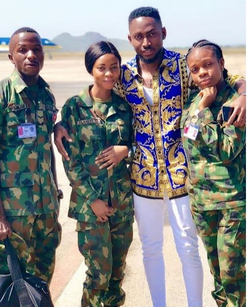 Miracle, BBNaija 2018 Winner, Miracle poses with two female soldiers