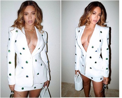 Beyonce shows off her cleavage and thighs in a skirt suit