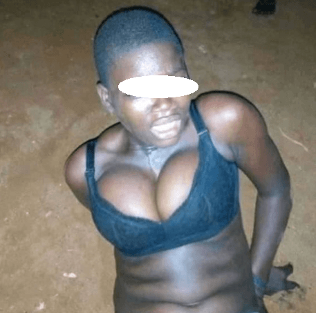 Alleged female thief is stripped and publicly humiliated after she was caught stealing with her boyfriend (photos)