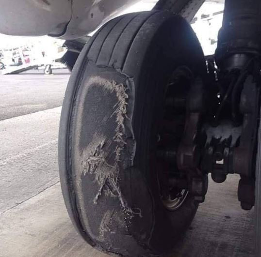 Musician, Alariwo of Africa shares scary photo of a commercial plane's tyre in Nigeria