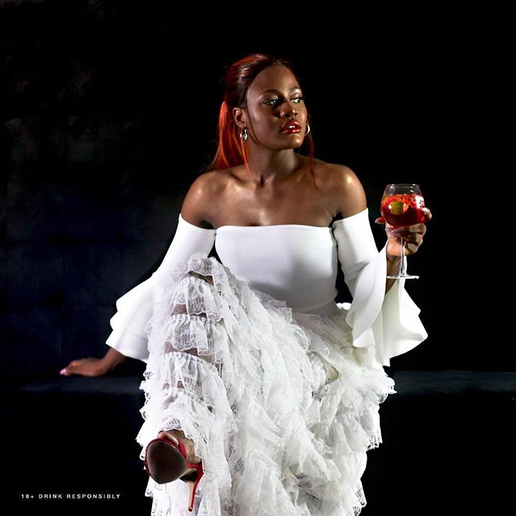 AY comedian calls out Alex Unusual's fan as she poses with glass of campari